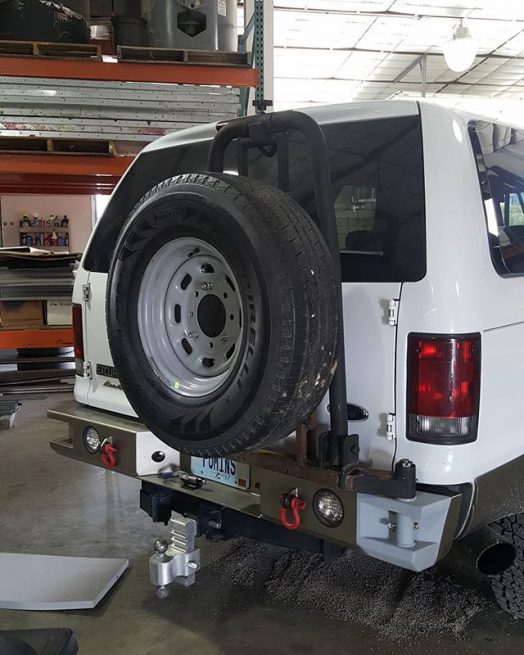 Something ford excursion swinging spare tire carrier