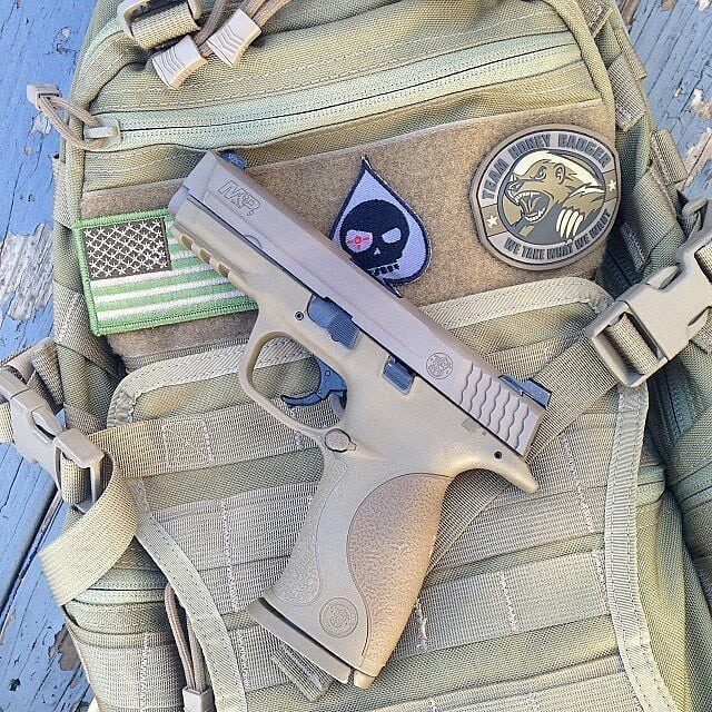 dzmedia 9mm M & P VTAC. Sitting on the @tripleaughtdesign Fast Pac EDC.  #mandpmonday #tadgear #honeybadger #instagood #picoftheday #igmilitia @sickguns @gunkings @gunsdaily1 #easter #molonlabe #2a #fuckisis #dailybadass @daily_badass @badass_daily  #molonlabe #mandp #pewpewpew #gun #shot #shooting #guns #maga #merka